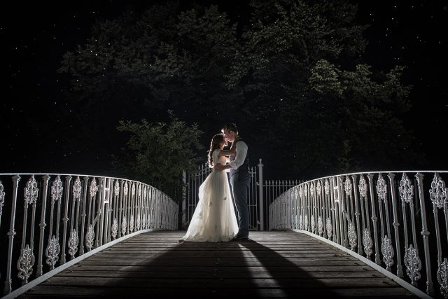 Bride and groom on bridge in South London wedding venue