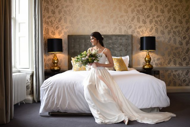 Bride sat in the beautiful Cherry room at Morden Hall