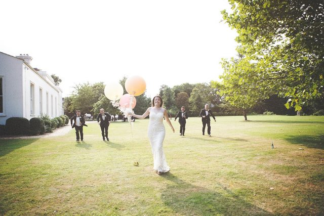 Bride with pastel coloured balloons