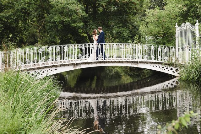 Couple on the bridge at a 18th Century country house wedding venue