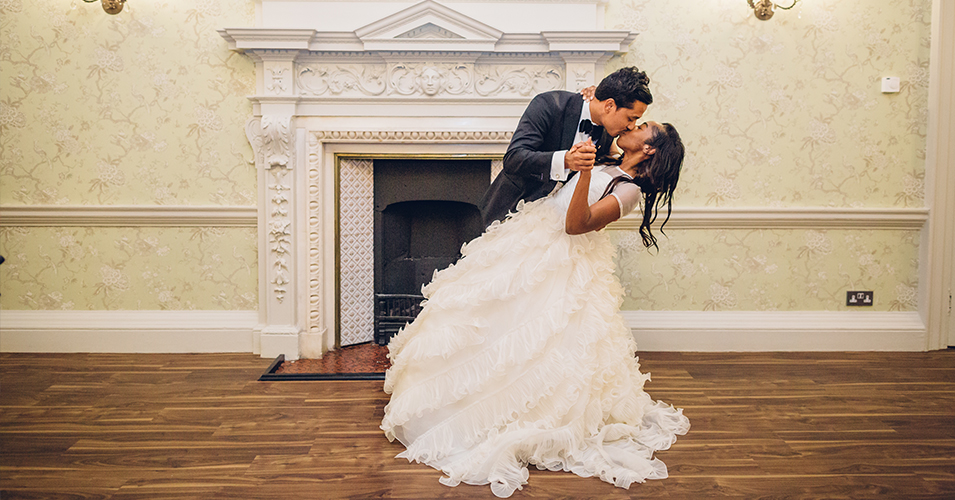 Angela and Praj grabbing a moment at Morden Hall wedding venue