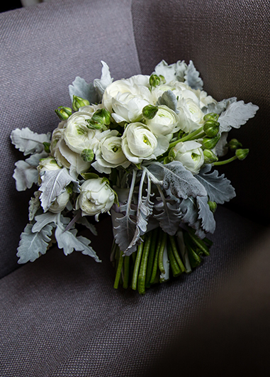 The bride's wedding bouquet included white roses for a beautiful winter wedding look