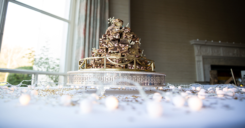 The couple got creative with their wedding cake and opted for stacked rocky road – wedding cake ideas