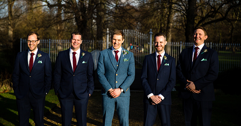 The groom wore a bespoke three-piece blue tweed suit as he stands with his groomsmen