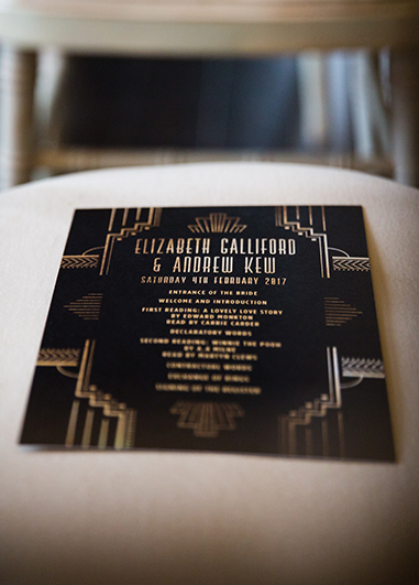 The wedding stationery consisted of a Gatsby art deco design on black card with gold writing
