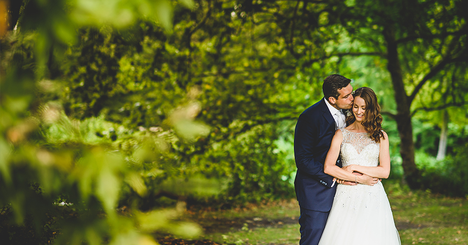A-bride-and-groom-embrace-in-the-gardens-of-this-luxury-wedding-venue-–-wedding-venues-London
