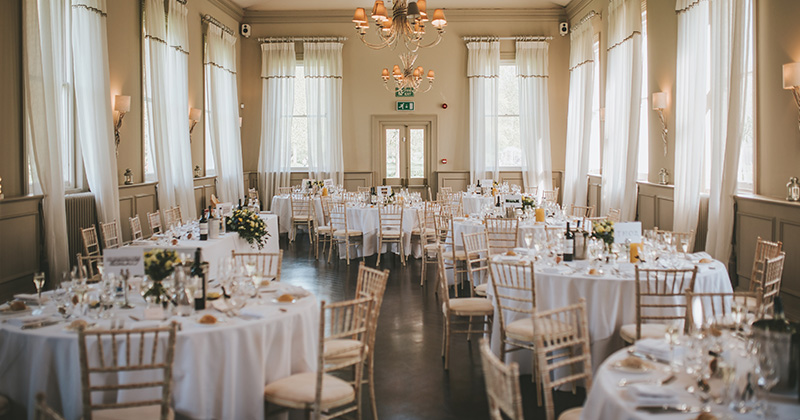 The Mulberry room is a light space with windows all around making it perfect for a wedding reception