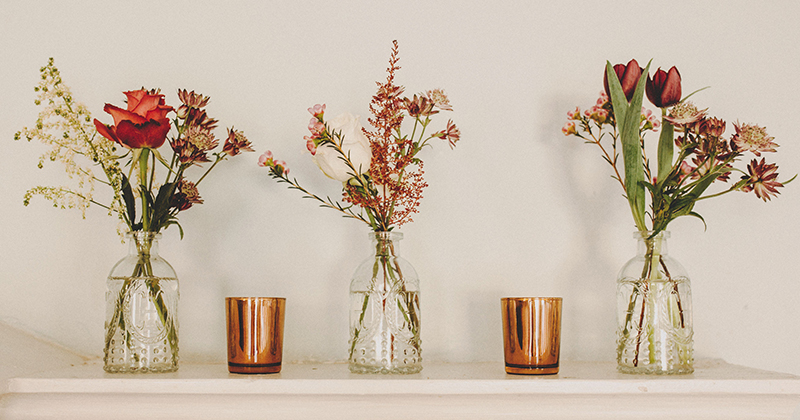 Keep it simple but effective with small jars of pretty autumn flowers and rose gold tealight holders
