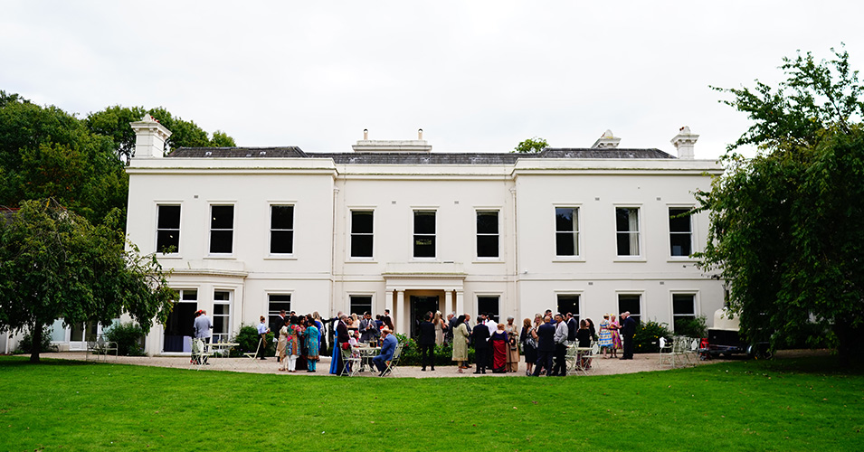 Wedding guests enjoy the wedding reception at Morden Hall in London