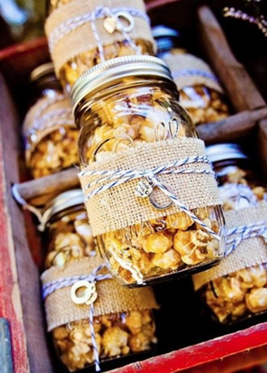 Homemade jars of popcorn decorated with natural hessian and string are perfect favours for your guests