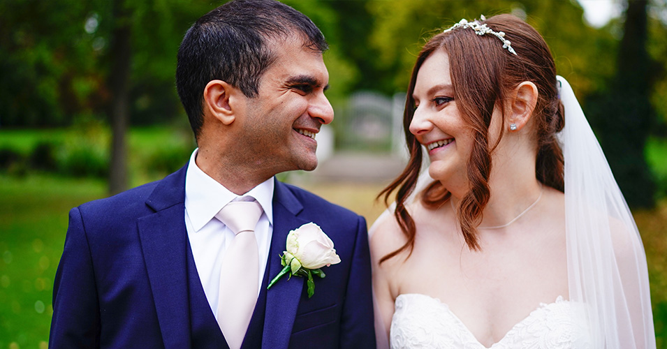 The happy couple pose for a photo at morden hall london