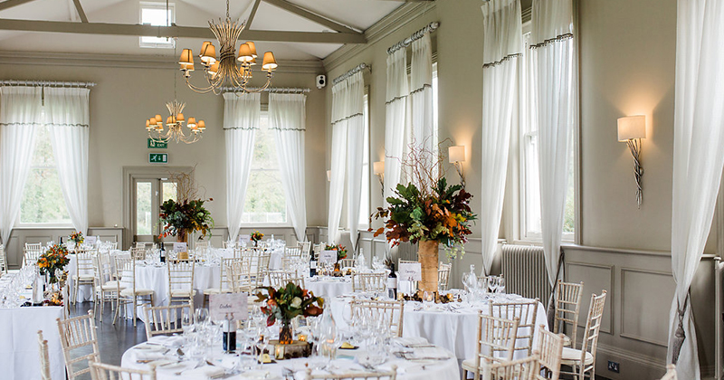 Bring the outside in using autumnal leaves and twigs as your centrepieces