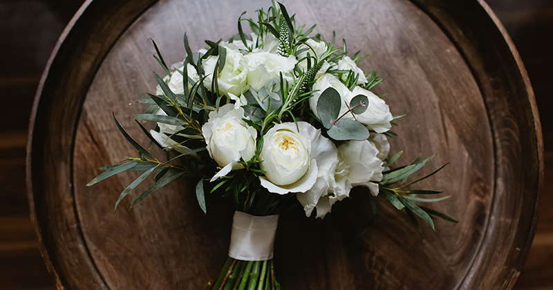 The stunning bridal bouquet of white peonies was captured in these wedding photos at Morden Hall London