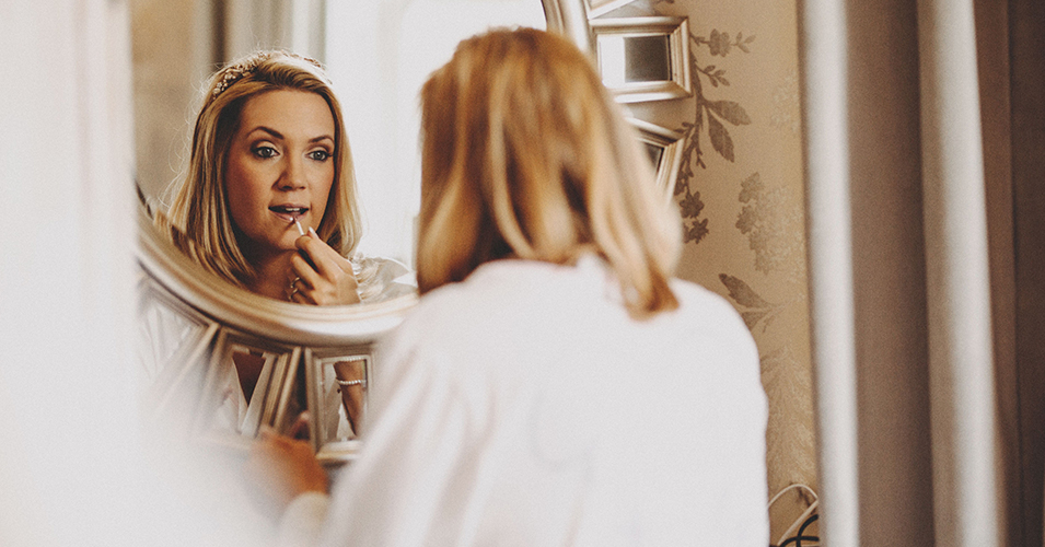 The bride prepares for the big day in the wedding preparation room at Morden Hall in London