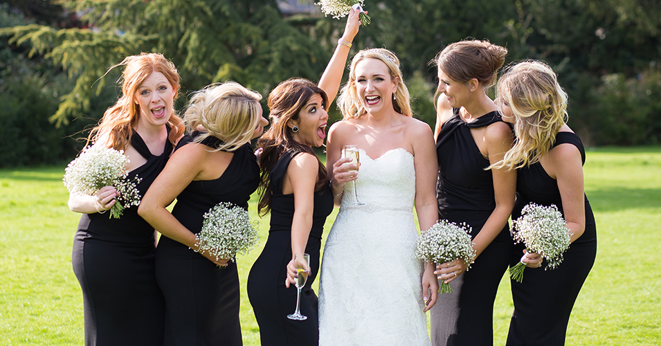 The bridesmaids wore elegant black gowns with contrasting gypsophila wedding bouquets at this country house wedding in London