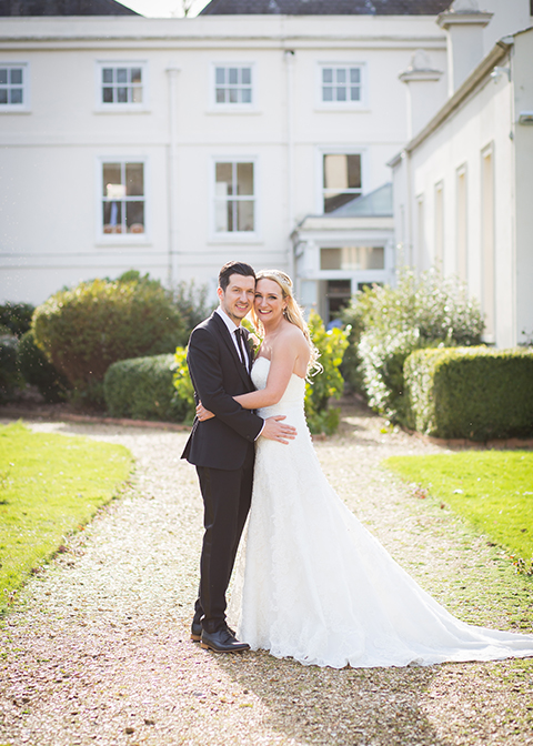 The bride's elegant white lace wedding dress contrasted perfectly against the groom's' classic black wedding suit at Morden Hall in London