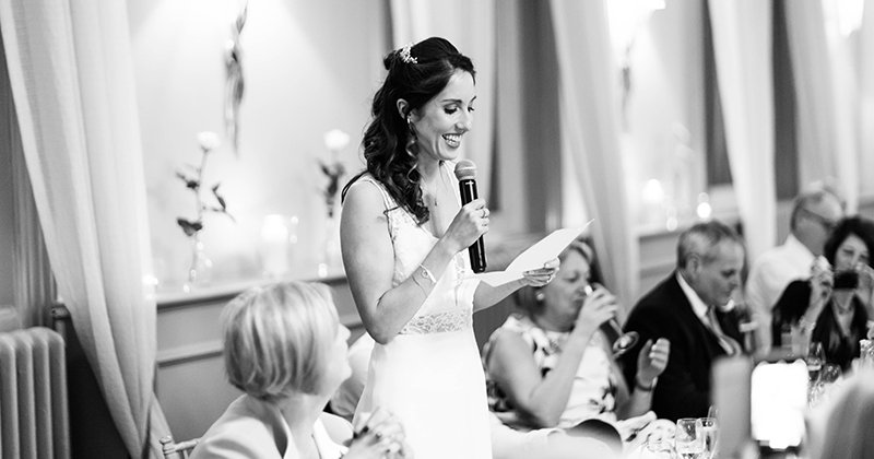 The happy newlywed bride makes a speech at this wedding at Morden Hall London