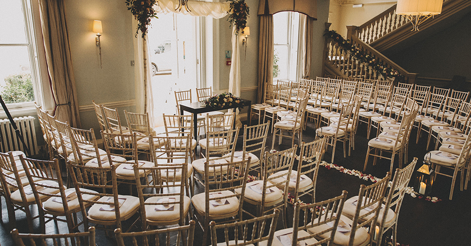 The chairs were laid out in a half circle around the wedding ceremony table with petals down the aisle at Morden Hall