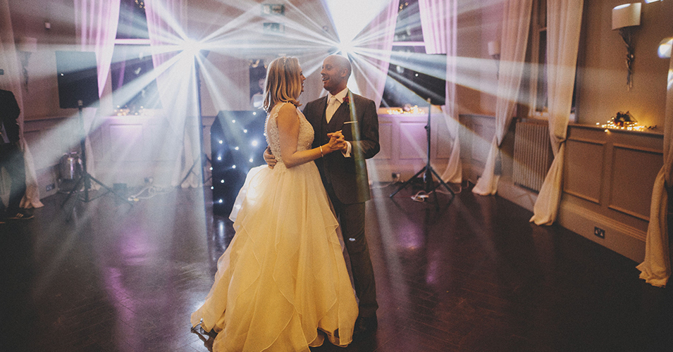 The bride and groom take to the floor for their first dance at Morden Hall in London