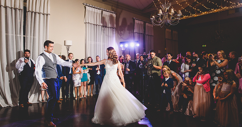 The happy newlyweds take to the floor for their first dance as their guests watch on at this London wedding venue