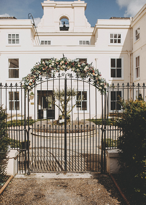 The gates were decorated with seasonal spring wedding flowers at this London wedding venue