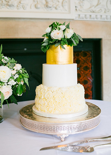 This 3 tier wedding cake was simply but beautifully decorated with butter cream roses and a gold painted top tier at this London wedding venue