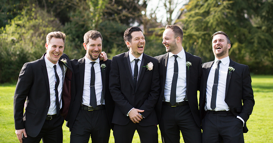 The groom and groomsmen wore classic black wedding suits with black ties at this London wedding venue.
