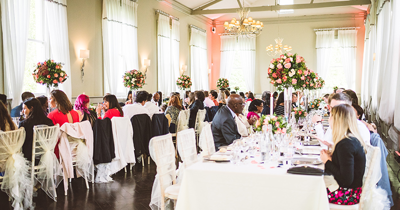 The wedding guests enjoy chatting while they wait for the speeches to begin at this London wedding venue