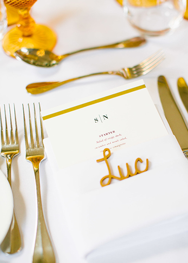 The couple chose simple but elegant place-settings with white printed menus and a touch of mustard décor at Morden Hall in London