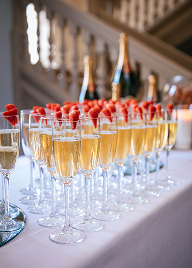 Champagne was served with strawberries at the drinks reception as this wedding at Morden Hall in London