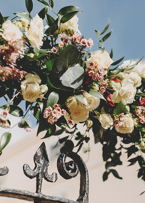 Pretty spring wedding flowers were used to decorate the gate at this wedding venue in London
