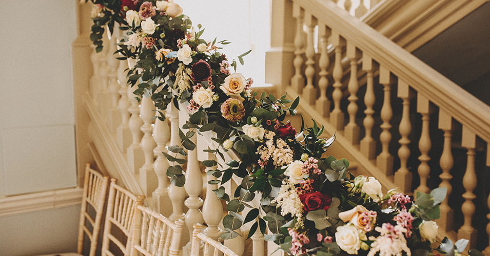 The staircase was decorated with beautiful spring wedding flowers at this London wedding venue