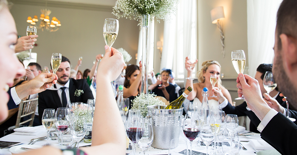The wedding guests raise a glass to the happy newlyweds at the wedding reception at this London wedding venue