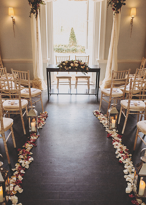 The wedding aisle was lined with pretty rose petals and lanterns at this London wedding venue