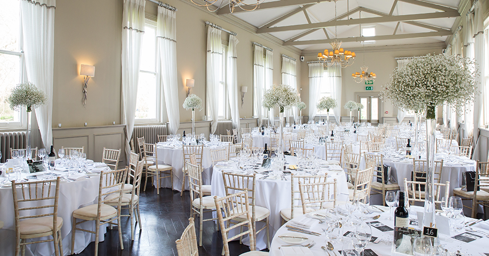 The Mulberry Suite at Morden Hall is elegantly decorated with lots of pretty white gypsophila in tall vases at Morden Hall in London.