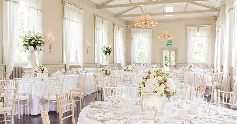 The elegant Mulberry Room was decorated with beautiful white wedding flowers at Morden Hall in London