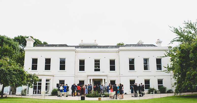 The wedding guests mingle before wedding ceremony at Morden Hall in London
