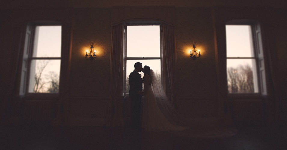 The happy newlyweds pose for a dramatic shot at this wedding venue in London