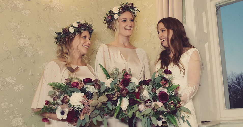The wedding bouquets and floral crowns were created using deep burgundy and pale pink blooms with lots of lush foliage at this winter wedding at Morden Hall in London