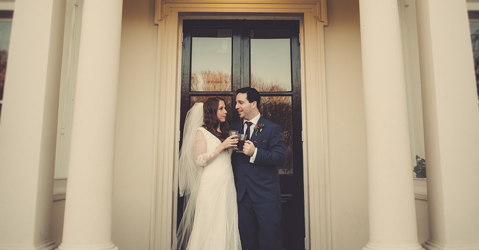 The happy newlyweds enjoy a celebratory drink after their wedding ceremony at Morden Hall in London