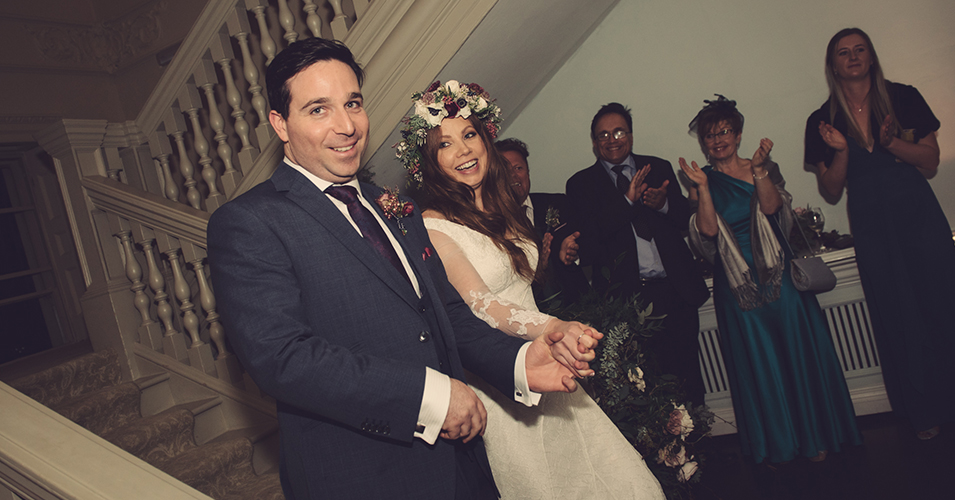 The happy couple make a grand entrance to their wedding evening celebrations at Morden Hall in London