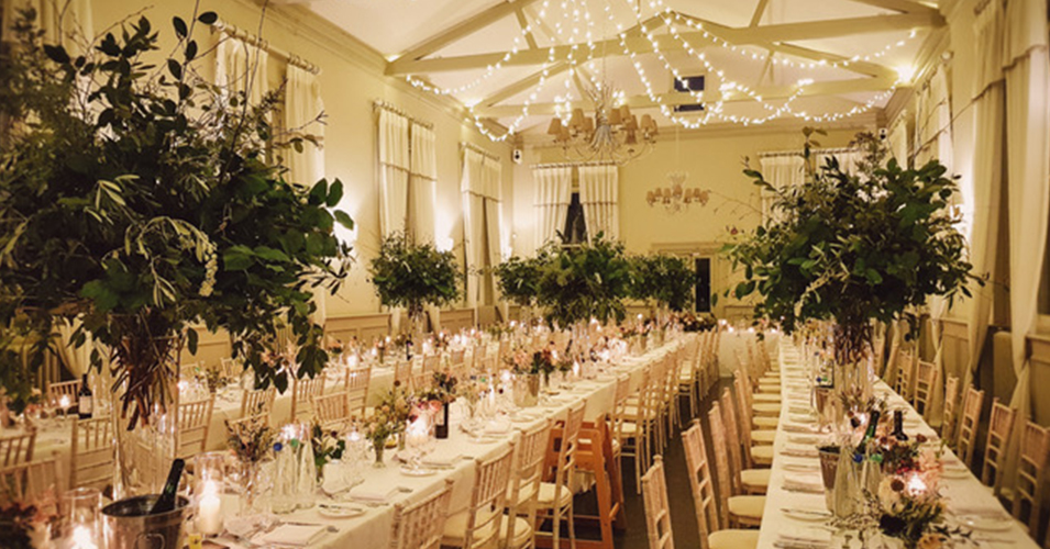 Large arrangements of lush foliage adorned the tables at this wedding at Morden Hall in London