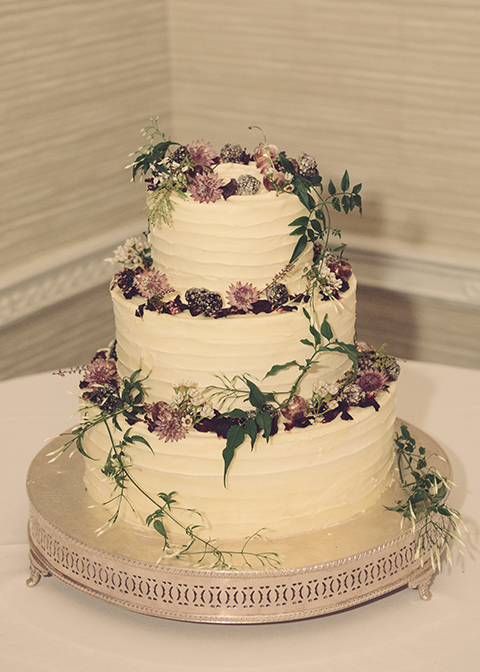 The three tier wedding cake was simply but elegantly decorated with delicate flowers at this winter wedding at Morden Hall