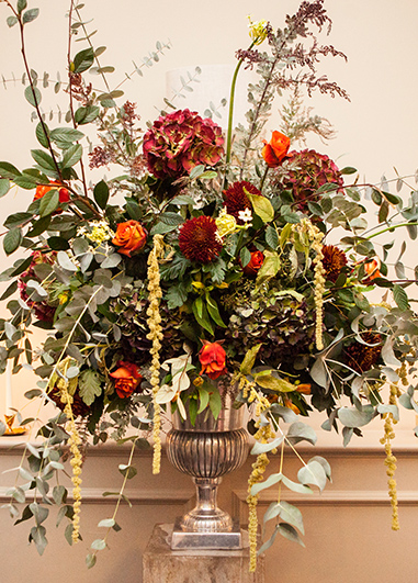 Deep red and burnt orange blooms with lots of seasonal foliage are perfect for your winter wedding at Morden Hall in London