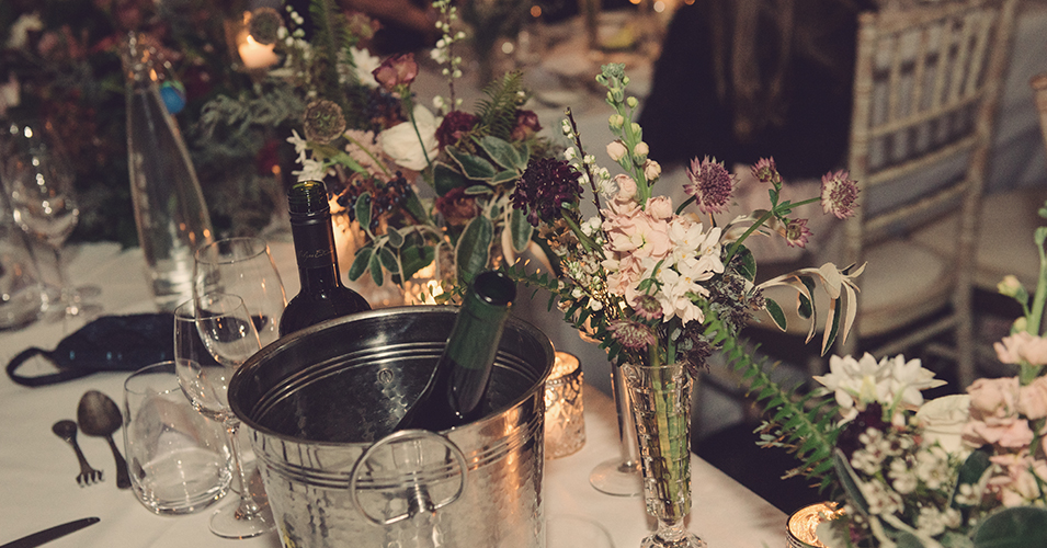 The tables were decorated with vases of pretty pink and mauve wedding flowers at this winter wedding in London