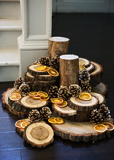 Piled wood slices and natural items make simply perfect decorations for your winter wedding at Morden Hall in London