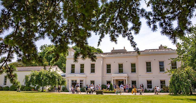 Wedding couples enjoy mingling in the sunshine at this tasting event at Morden Hall in London