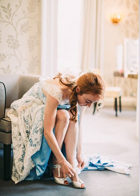 The bride prepares for the day ahead in the bridal preparation room at Morden Hall in London