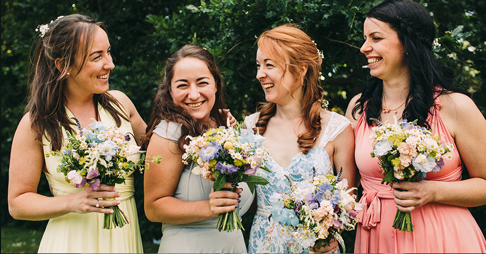 The bridesmaids wore pretty pastel coloured bridesmaid dresses that complimented the bride's dress perfectly at Morden Hall