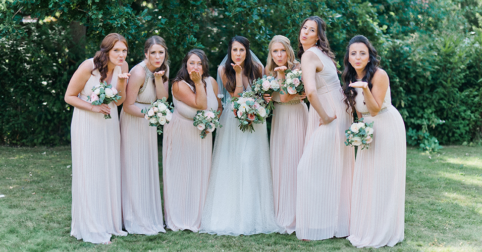 The bridesmaids wore simply elegant blush pink gowns at this country house wedding in London
